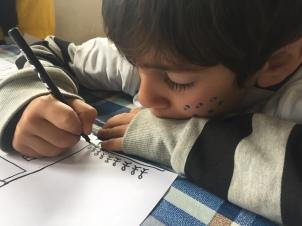 niño dibujando retiro 2018